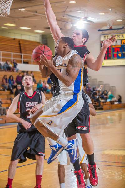 "Junior guard Ronnie Baker muscles his way inside for a shot during the second half of the Nanooks' 81-58 win over Saint Martin's Jan. 10 in the Patty Center.  <div class=""ss-paypal-button"">Filename: ATH-13-3695-15.jpg</div><div class=""ss-paypal-button-end"" style=""""></div>"
