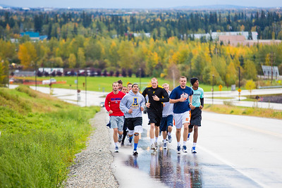 Members of the Nanook basketball team get in a workout running up Tanana Loop on a recent rainy afternoon.  Filename: ATH-12-3535-4.jpg