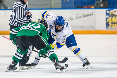 Cody Kunyk, 37, wins the face-off during the Nanooks' 2-1 win over North Dakota in the Carlson Center.  Filename: ATH-12-3601-38.jpg