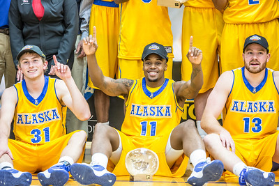 Nanooks Cody Pierson, 31, Ronnie Baker, 11, and Dallen Bills, 13, are all smiles after claiming the championship of the GCI Alaska Invitational tournament.  Filename: ATH-13-4005-140.jpg