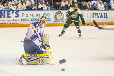 Goalie Sean Cahill blocks a shot during the Nanooks game against the UAA Seawolves for the 2014 Governor's Cup March 8 in the Carlson Center.  Filename: ATH-14-4109-102.jpg