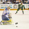 "Goalie Sean Cahill blocks a shot during the Nanooks game against the UAA Seawolves for the 2014 Governor's Cup March 8 in the Carlson Center.  <div class=""ss-paypal-button"">Filename: ATH-14-4109-102.jpg</div><div class=""ss-paypal-button-end""></div>"