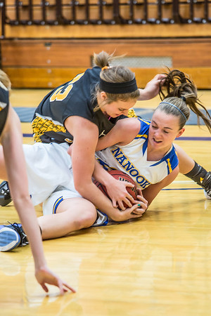 Freshman forward Jordan Wilson wraps up a loose ball during the first half of the championship game of the North Star Invitational Tournament against Wayne State in the Patty Gym.  Filename: ATH-13-4010-10.jpg