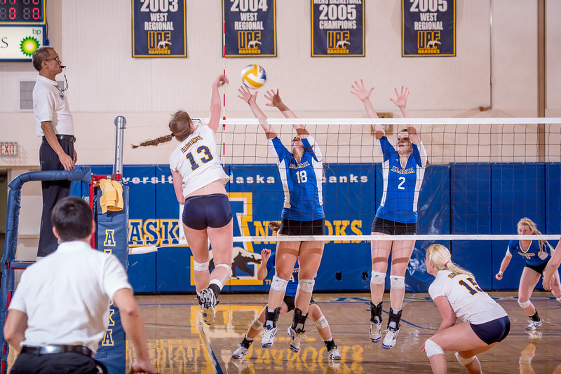 "Freshman Megan Morrison, #18, and sophomore Morgan Tebbs, #2, wall up for a block during the Nanooks' match against Montana State-Billings in the Patty Center.  <div class=""ss-paypal-button"">Filename: ATH-12-3638-136.jpg</div><div class=""ss-paypal-button-end"" style=""""></div>"