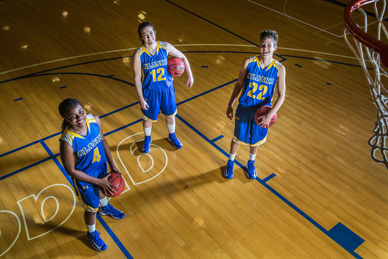"Sophomores Benissa Bulaya, left, and Kelly Logue, center, join senior Jacqueline Lovato on the Patty Center court.  <div class=""ss-paypal-button"">Filename: ATH-12-3625-007.jpg</div><div class=""ss-paypal-button-end"" style=""""></div>"