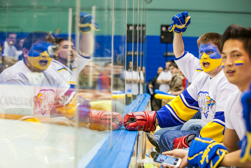 """Sporting a hockey jersey complete with gloves, Dylan Hyland roots for the Alaska Nanooks during the 2014 Governor's Cup tournament against University of Alaska Fairbanks.  <div class=""""ss-paypal-button"""">Filename: ATH-14-4105-90.jpg</div><div class=""""ss-paypal-button-end""""></div>"""