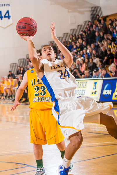 "Junior point guard Pat Voeut get off an unbalanced jumper during the Nanooks game against the UAA Seawolves in the Patty Center.  <div class=""ss-paypal-button"">Filename: ATH-13-3700-174.jpg</div><div class=""ss-paypal-button-end"" style=""""></div>"