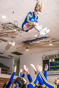The UAF cheerleading squad performs a variety of poses and routines during a practice session in the Patty Gym.  Filename: ATH-13-3751-69.jpg