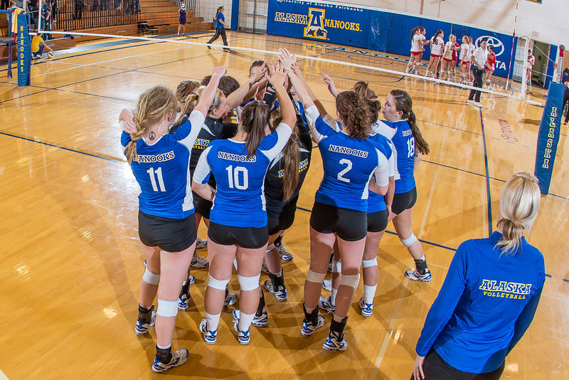 "The Nanooks huddle up for high fives after their win over Simon Fraser in the Patty Center.  <div class=""ss-paypal-button"">Filename: ATH-12-3581-210.jpg</div><div class=""ss-paypal-button-end"" style=""""></div>"