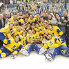 "The UAF hockey team huddles around the Governor's Cup on the ice in the Carlson Center after their thrilling victory over the UAA Seawolves to claim the coveted trophy for the third time in the past four years.  <div class=""ss-paypal-button"">Filename: ATH-12-3304-328.jpg</div><div class=""ss-paypal-button-end"" style=""""></div>"