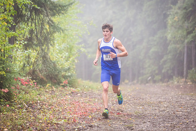 Stefan Hajdukovich dashes toward the finish line at a meet against Montana State University Billings and Seattle Pacific University  on a foggy Saturday morning on campus.  Filename: ATH-13-3933-53.jpg