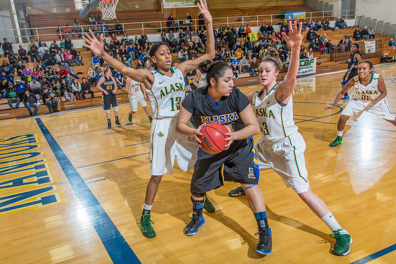 """Senior Ruth O'Neal looks to pass out of a double-team during the second half of the Nanooks game against the rival Seawolves from UAA Jan. 18 in the Patty Gym.  <div class=""""ss-paypal-button"""">Filename: ATH-14-4041-5.jpg</div><div class=""""ss-paypal-button-end"""" style=""""""""></div>"""