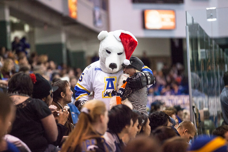 """The UAF Nanook mascot hands a fan a teddy bear before the game Saturday, Dec. 8, 2012 at the Carlson Center.  <div class=""""ss-paypal-button"""">Filename: ATH-12-3676-12.jpg</div><div class=""""ss-paypal-button-end"""" style=""""""""></div>"""