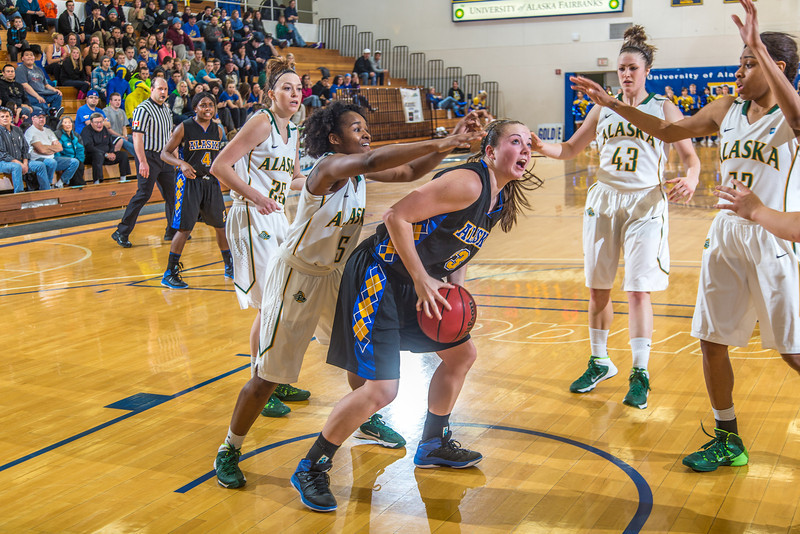 """Freshman Jordan Wilson lookos to score in the lane during the second half of the Nanooks game against the rival Seawolves from UAA Jan. 18 in the Patty Gym.  <div class=""""ss-paypal-button"""">Filename: ATH-14-4041-38.jpg</div><div class=""""ss-paypal-button-end"""" style=""""""""></div>"""