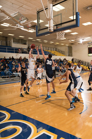 Junior guard Brandon Davis gets inside for a short jumper during the Nanooks' 92-69 win over Concordia University Feb. 20 in the Patty Gym.  Filename: ATH-16-4810-59.jpg