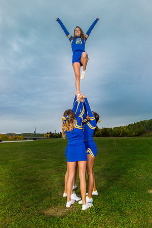 UAF cheerleaders strike a pose in front of the SRC on the Fairbanks campus.  Filename: ATH-13-3943-68.jpg