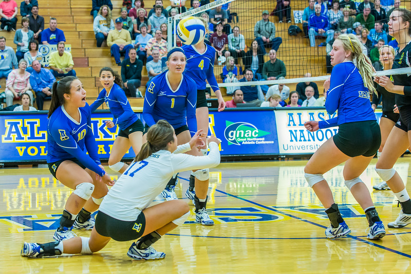 "Action from the Nanooks match in the 2013 Nanook Classic tournament in the Patty Center.  <div class=""ss-paypal-button"">Filename: ATH-13-3930-67.jpg</div><div class=""ss-paypal-button-end""></div>"