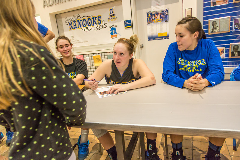 """Women's basketball players sign autographs for members of the Junior Nanooks Club between games of a Jan. 18 doubleheader in the Patty Gym.  <div class=""""ss-paypal-button"""">Filename: ATH-14-4041-98.jpg</div><div class=""""ss-paypal-button-end"""" style=""""""""></div>"""