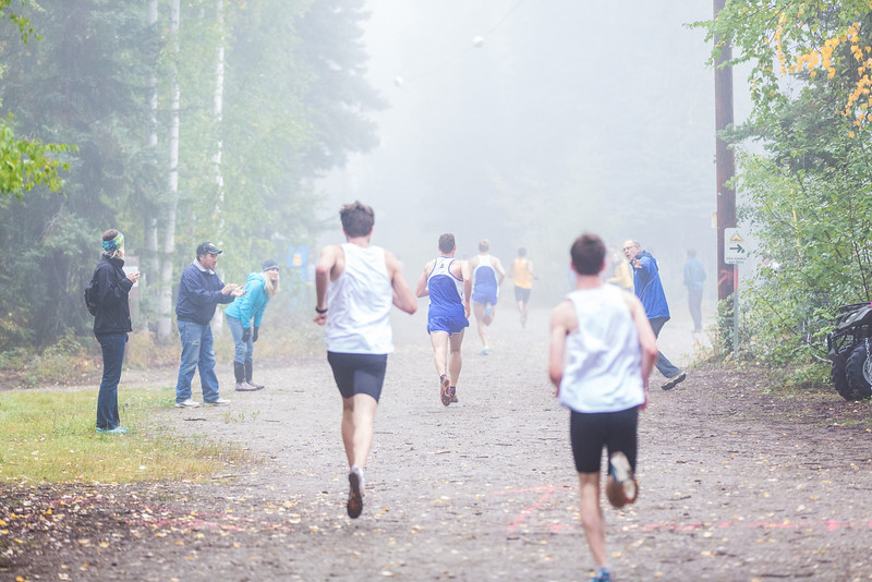 """Runners dash toward the finish line at a meet against Montana State University Billings and Seattle Pacific University on a foggy Saturday morning on campus.  <div class=""""ss-paypal-button"""">Filename: ATH-13-3933-42.jpg</div><div class=""""ss-paypal-button-end"""" style=""""""""></div>"""