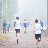 "Runners dash toward the finish line at a meet against Montana State University Billings and Seattle Pacific University on a foggy Saturday morning on campus.  <div class=""ss-paypal-button"">Filename: ATH-13-3933-42.jpg</div><div class=""ss-paypal-button-end"" style=""""></div>"