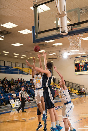 Senior guard Joe Slocum gets inside for two points during the Nanooks' 92-69 win over Concordia University Feb. 20 in the Patty Gym.  Filename: ATH-16-4810-67.jpg