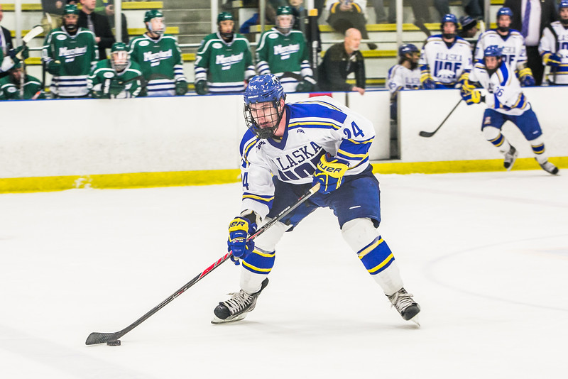 "Sophomore Nolan Huysmans controls the puck late in the Nanooks' game against the Mercyhurst Lakers in the Patty Ice Arena.  <div class=""ss-paypal-button"">Filename: ATH-13-3982-178.jpg</div><div class=""ss-paypal-button-end"" style=""""></div>"