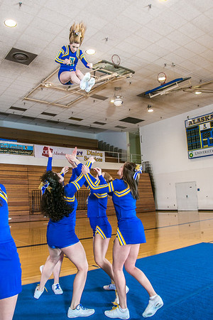 The UAF cheerleading squad performs a variety of poses and routines during a practice session in the Patty Gym.  Filename: ATH-13-3751-67.jpg