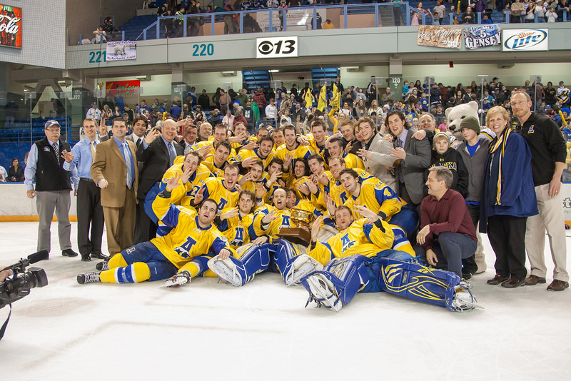 """Alaska Governor Sean Parnell (kneeling at lower right) joins the Nanooks in their post-game celebration and photos with the Alaska Airlines Governor's Cup after their thrilling victory over the UAA Seawolves to claim the coveted trophy for the third time in the past four years.  <div class=""""ss-paypal-button"""">Filename: ATH-12-3304-334.jpg</div><div class=""""ss-paypal-button-end"""" style=""""""""></div>"""