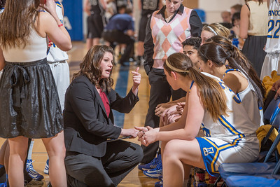 Coach Cody Bench talks to her team during a timeout during a game against Montana State Billings.  Filename: ATH-13-3720-13.jpg