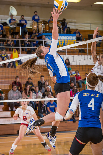 """Sophomore Britt Glaeser skies to tip the ball at the net in the Nanooks' win over Simon Fraser in the Patty Center.  <div class=""""ss-paypal-button"""">Filename: ATH-12-3581-63.jpg</div><div class=""""ss-paypal-button-end"""" style=""""""""></div>"""