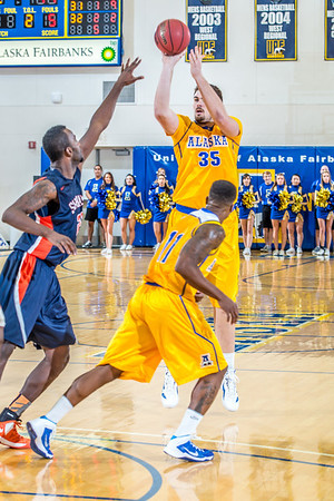 Senior Sergej Pucar hits a three-pointer fro the top of the key in the Nanooks' 83-72 win over Fresno Pacific in the championship game of the GCI Alaska Invitational tournament. Pucar was a huge factor in the game, scoring 25 points, including 11 straight, during a crucial 23-6 second-half run as the Nanooks pulled away.  Filename: ATH-13-4005-73.jpg