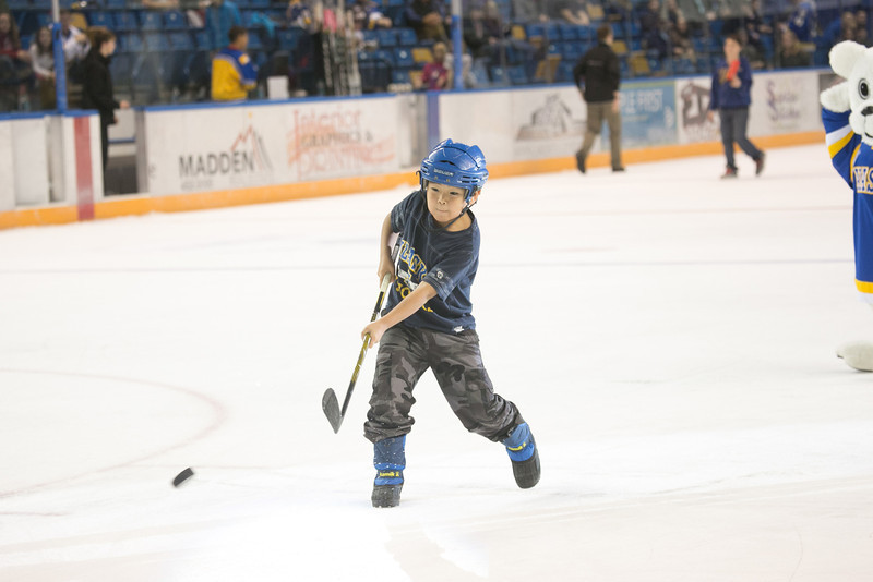 """Eight-year-old Ambrose Phillips gets a chance to score with the puck between periods during the Nanooks' 2-1 win over North Dakota in the Carlson Center.  <div class=""""ss-paypal-button"""">Filename: ATH-12-3601-222.jpg</div><div class=""""ss-paypal-button-end"""" style=""""""""></div>"""