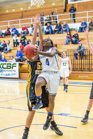 Point guard Benissa Bulaya tries a reverse layup during the first half of the championship game of the North Star Invitational Tournament against Wayne State in the Patty Gym.  Filename: ATH-13-4010-9.jpg