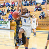 "Point guard Benissa Bulaya tries a reverse layup during the first half of the championship game of the North Star Invitational Tournament against Wayne State in the Patty Gym.  <div class=""ss-paypal-button"">Filename: ATH-13-4010-9.jpg</div><div class=""ss-paypal-button-end"" style=""""></div>"