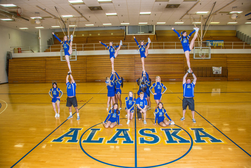 """The 2014 Nanook cheerleaders pose in the Patty Gym.  <div class=""""ss-paypal-button"""">Filename: ATH-14-4044-76.jpg</div><div class=""""ss-paypal-button-end"""" style=""""""""></div>"""