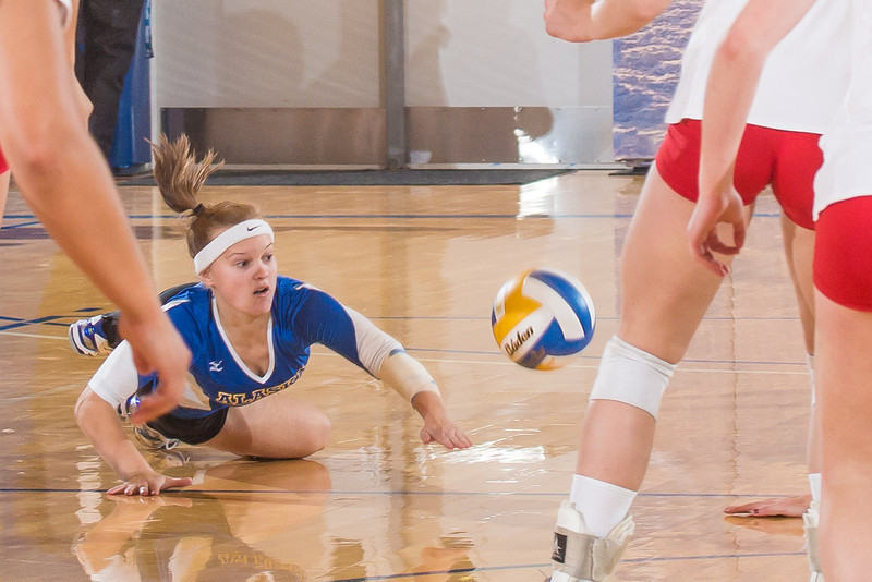 "Freshman Katlyn Mataya dives for a dig during the Nanooks' win over Simon Fraser in the Patty Center.  <div class=""ss-paypal-button"">Filename: ATH-12-3581-186.jpg</div><div class=""ss-paypal-button-end"" style=""""></div>"