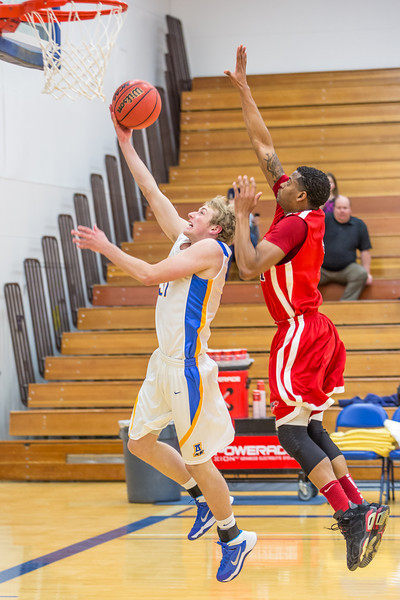 """Guard Cody Pierson finishes a fast break against Simon Fraser during another Nanook win in the Patty Gym.  <div class=""""ss-paypal-button"""">Filename: ATH-14-4029-42.jpg</div><div class=""""ss-paypal-button-end"""" style=""""""""></div>"""