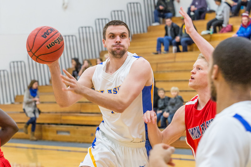 """Forward Stefan Tica passes to an open teammate against Simon Fraser during another Nanook win in the Patty Gym.  <div class=""""ss-paypal-button"""">Filename: ATH-14-4029-4.jpg</div><div class=""""ss-paypal-button-end"""" style=""""""""></div>"""