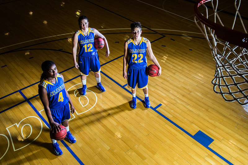 """Sophomores Benissa Bulaya, left, and Kelly Logue, center, join senior Jacqueline Lovato on the Patty Center court.  <div class=""""ss-paypal-button"""">Filename: ATH-12-3625-004.jpg</div><div class=""""ss-paypal-button-end"""" style=""""""""></div>"""