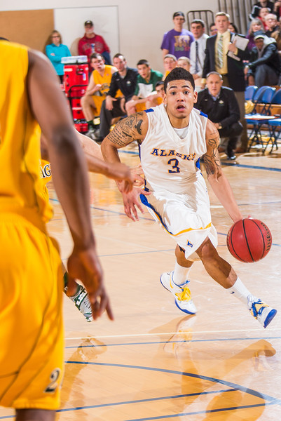 """Senior guard Dominique Brinson drives toward the lane during the Nanooks game against the UAA Seawolves in the Patty Center.  <div class=""""ss-paypal-button"""">Filename: ATH-13-3700-177.jpg</div><div class=""""ss-paypal-button-end"""" style=""""""""></div>"""