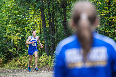 Ross MacDougal finishes the race during a cross country meet Thursday, August 30, 2012 on the UAF West Ridge ski trails..  Filename: ATH-12-3530-84.jpg