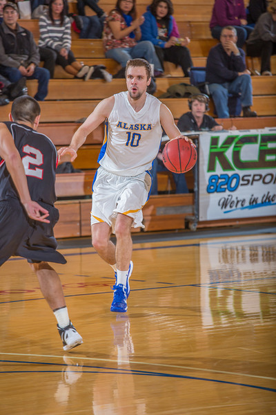 """Junior forward Stefan Tica brings the ball into the front court during the second half of the Nanooks' 81-58 win over Saint Martin's Jan. 10 in the Patty Center.  <div class=""""ss-paypal-button"""">Filename: ATH-13-3695-39.jpg</div><div class=""""ss-paypal-button-end"""" style=""""""""></div>"""