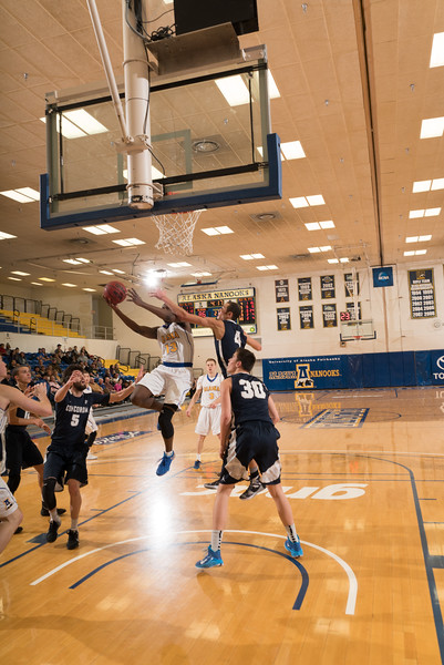 """Junior forward Bangaly Kaba gets inside for a guarded layup during the Nanooks' 92-69 win over Concordia University Feb. 20 in the Patty Gym.  <div class=""""ss-paypal-button"""">Filename: ATH-16-4810-77.jpg</div><div class=""""ss-paypal-button-end""""></div>"""