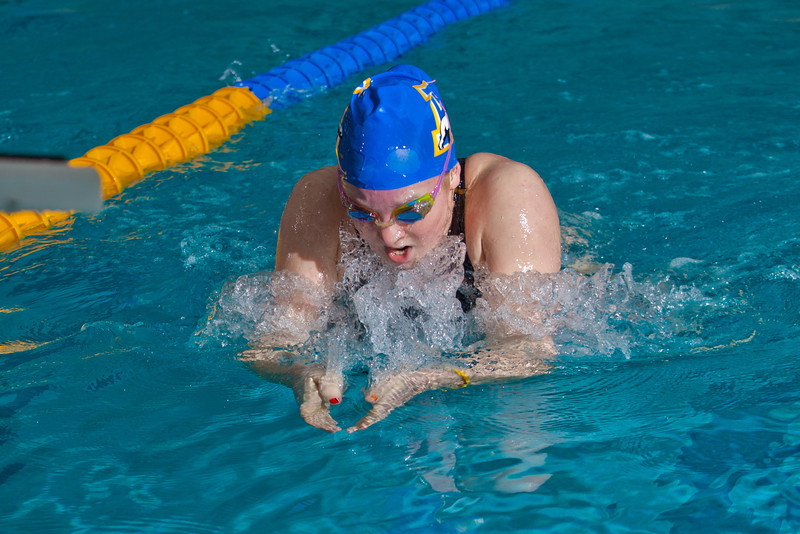 """Freshman Genevieve Johnson swims the breast stroke for the Nanooks' A squad in the 400-yard medley relay during a dual meet against Colorado Mesa in the Patty pool.  <div class=""""ss-paypal-button"""">Filename: ATH-12-3267-002.jpg</div><div class=""""ss-paypal-button-end"""" style=""""""""></div>"""