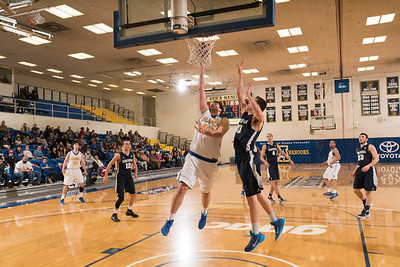 Senior Almir Hadzisehovic lays one in from close distance during the Nanooks' 92-69 win over Concordia University Feb. 20 in the Patty Gym.  Filename: ATH-16-4810-75.jpg