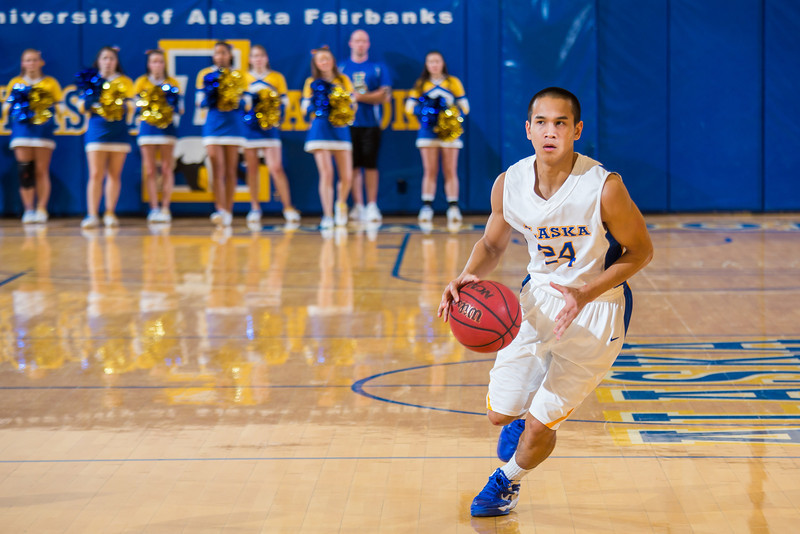 """Junior point guard Pat Voeut looks for an open teammate during the Nanooks game against the UAA Seawolves in the Patty Center.  <div class=""""ss-paypal-button"""">Filename: ATH-13-3700-139.jpg</div><div class=""""ss-paypal-button-end"""" style=""""""""></div>"""