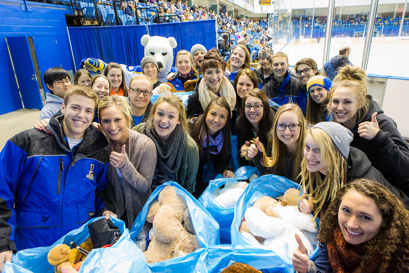 """Student athletes pose for a photograph after collecting plush toys on the ice during the 3rd Annual Teddy Bear Toss at a hockey game in Carlson Center. The Student-Athlete Advisory Committee sponsored the event that collects toys for families during the holiday season.  <div class=""""ss-paypal-button"""">Filename: ATH-13-4011-76.jpg</div><div class=""""ss-paypal-button-end"""" style=""""""""></div>"""