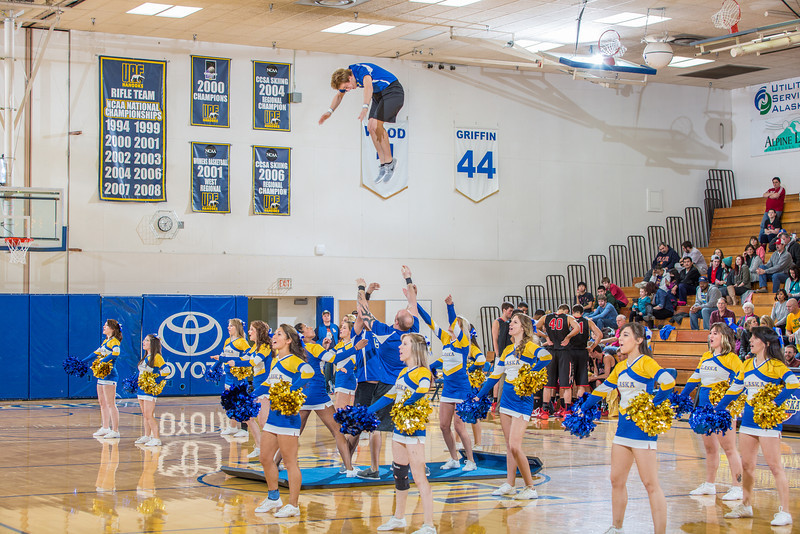 """UAF cheerleaders entertain the crowd during a timeout in the Nanooks' game against Northwest Nazarene in the Patty Gym.  <div class=""""ss-paypal-button"""">Filename: ATH-14-4041-186.jpg</div><div class=""""ss-paypal-button-end"""" style=""""""""></div>"""