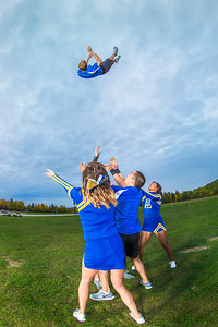 UAF cheerleaders practice in front of the SRC on the Fairbanks campus.  Filename: ATH-13-3943-104.jpg