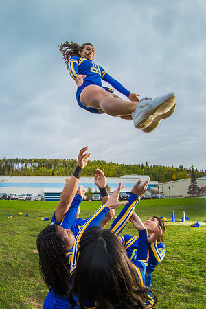 UAF cheerleaders practice in front of the SRC on the Fairbanks campus.  Filename: ATH-13-3943-93.jpg